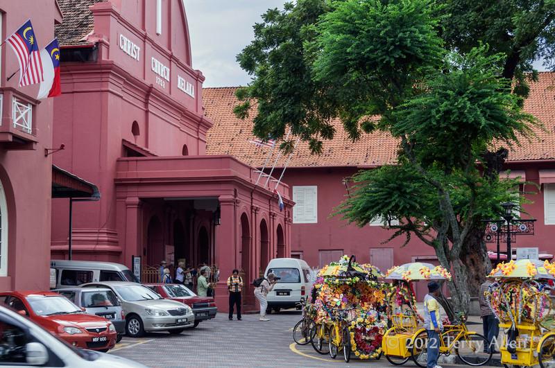 Christ-Church-Malacca-1753-with-pedicabs,-Malaysia