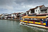 River-boat-and-old-town,-Malacca-River,-Malaysia