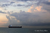 Freighter-waiting-in-Malacca-Strait-at-sunrise