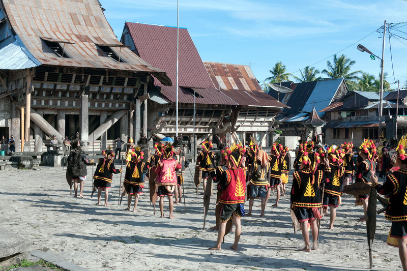 Warriors massing in front of chief's house, Bawomataluo village, Nias Island.