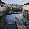 Outrigger canoe. wharf buildings and reflections galore, Teluk Dalam harbour, Nias Island, Sumatra<br /> <br /> After tomorrow, my ability to post or comment will be extremely limited for 3 weeks or so as I head off on another adventure.