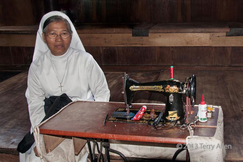 Nun by old Standard treadle sewing machine c1900, Nias Island, Sumatra