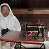 Nun by old Standard treadle sewing machine c1900, Nias Island, Sumatra