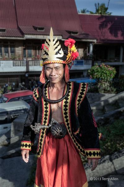 Portrait of a Nias warrior in ceremonial dress, Bawomatuluo Village, Nias Island, Sumatra