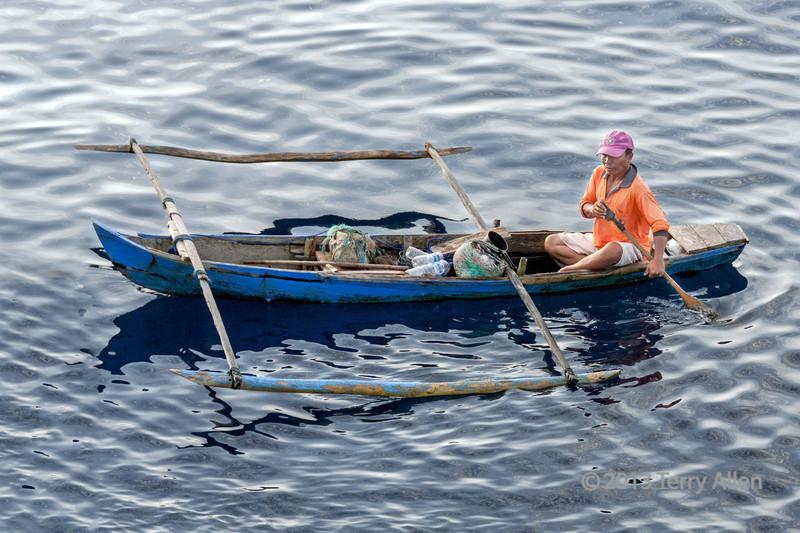 Fisherman in outrigger canoe, Tuluk Dalam harbour, Nias Island, Sumatra