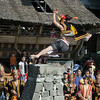 Stone Jumper in mid-jump-2, Bawomatuluo village, Nias Island, Sumatra<br /> <br /> Stone Jumping is a manhood ritual where young men leap over stone towers 2 to 2.5 meters high.The take-off stone can just barely be seen in the lower rigiht.