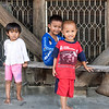Nias children, Bawomatuluo Village, Nias Island, Sumatra<br /> <br /> The children are posing in front of a Nias house, which are built on pilings with the living quarters on the second floor, entered by a narrow steep stairway (for defensive purposes).