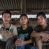 Three 'cool' young men, Bawomatuluo village, Niias Island, Sumatra<br /> <br /> One is engaged with my camera, one appears to be in his own little world, and one is multi-tasking with his cell phone and IPad.