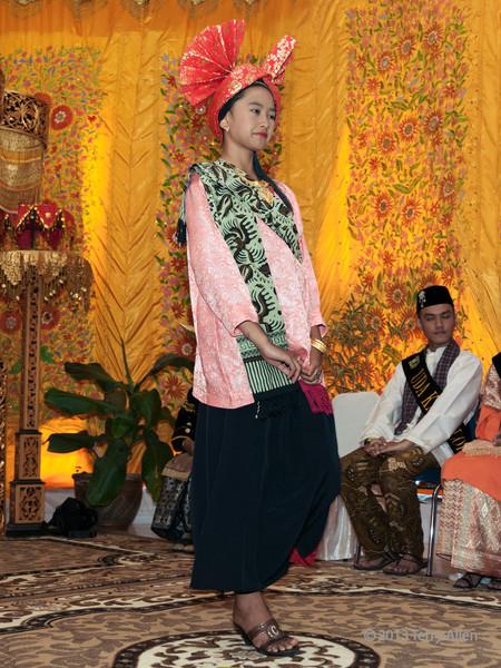 Young woman wearing traditional dress at Minangkabau wedding feast, Cupek, West Sumatra