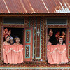Minangkabau women at the window of a traditional 'big house', Solok, West Sumatra