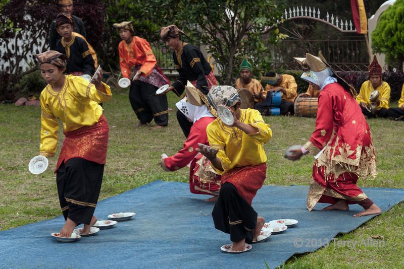 Minangkabau dancers doing traditional egg dance, Cupek, West Sumatra