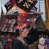 Minangkabau woman carrying tray of food to wedding feast, Solok, West Sumatra