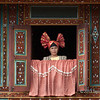 """Portrait of a Minangkabau woman at the window of a traditional 'big house', Solok, West Sumatra<br /> <br /> These houses are called Rumah Gadang or 'spired roof house' and are used for village ceremonies such as feasts and weddings.  The whole house, with its buffalo horn-shaped roof line, can be seen here: <a href=""""http://goo.gl/5zQAst"""">http://goo.gl/5zQAst</a>"""