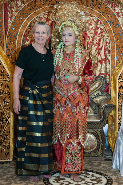 Terry with a Minangkabau bride, Cupak, West Sumatra<br /> <br /> I'm wearing a hand woven, gold-striped sarong that I bought in the local area and still have.