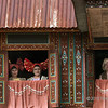 Minangkabau women at the window of a traditional house (Rumah Gadang), Solok, West Sumatra