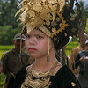 Girl in traditional dress in wedding procession, Solek, West Sumatra