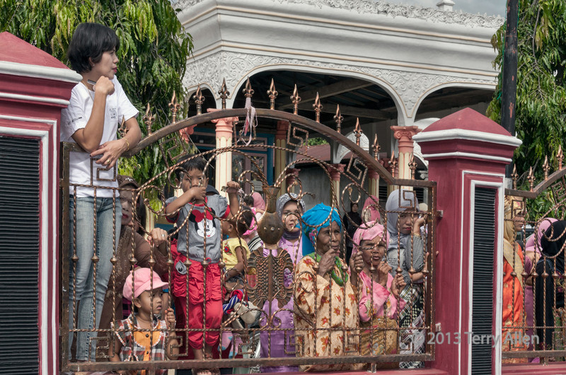 Minangkabau villagers watching the wedding procession through an intricate fence, Solek,West Sumatra (best seen at larger sizes)