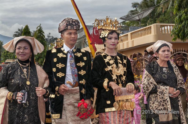 Minangkabau bride and groom on way to ceremony Solok, West Sumatra