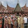 Minangkabau villagers in traditional dress at 'big house' (Rumah Gadang), Solok, West Sumatra