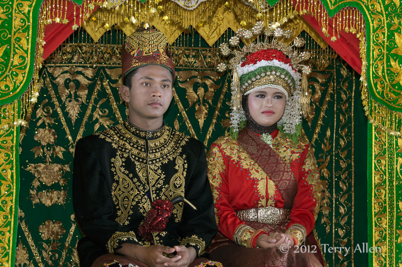 Bride-and-groom,-Aceh-wedding,-Pirak-Timu,-Aceh-Province<br /> <br /> 8. The bride and groom then occupied a fabulously colorful platform and sat through some more speeches