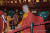 Monk-timing-chanting,-Bhudda-Tooth-Temple,-Singapore
