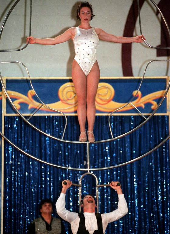 . Direct from South America on high perch pole husband & wife balancing act The Desparados perform feats of skill in the gymnamsium at Milford High School , as part of the Cole Indoor Circus. Here Robin Valencia balances on a steel circular ring resting on her husband Cha-chi\'s shoulders.