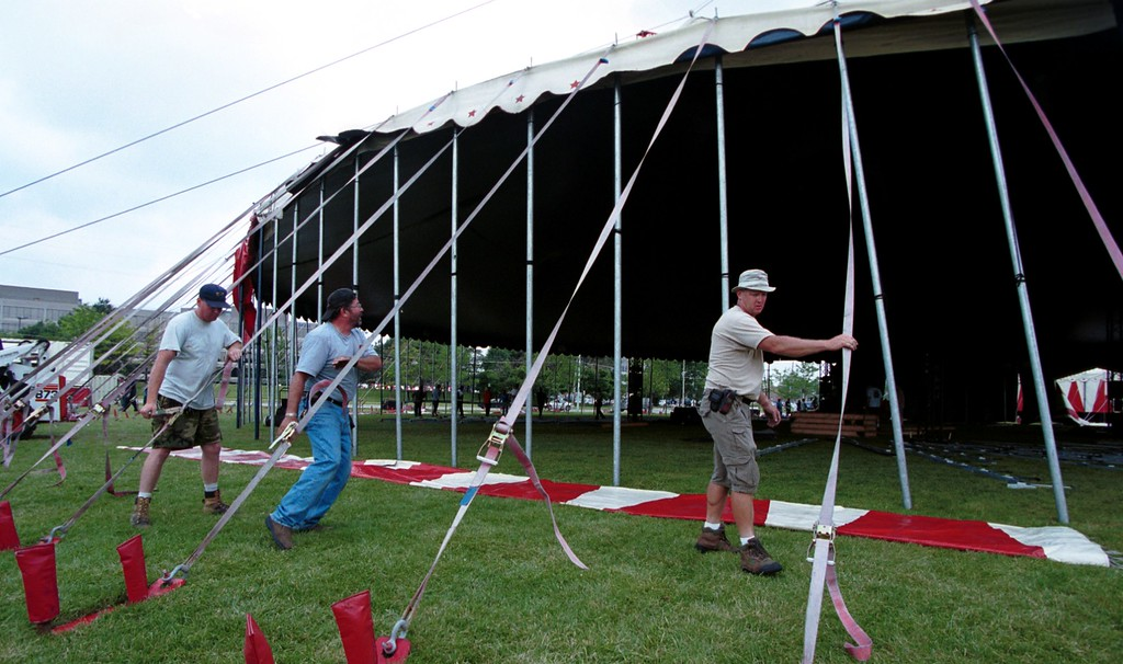 . Circus workers left o right; Mike Murphy, Charlie Hortobagyi & Eric Jaeger set-up the tent for Friday, June 23- Sunday July16 show for the Barnum\'s KaleidOscape Circus held outside the Southfield Civic Center.