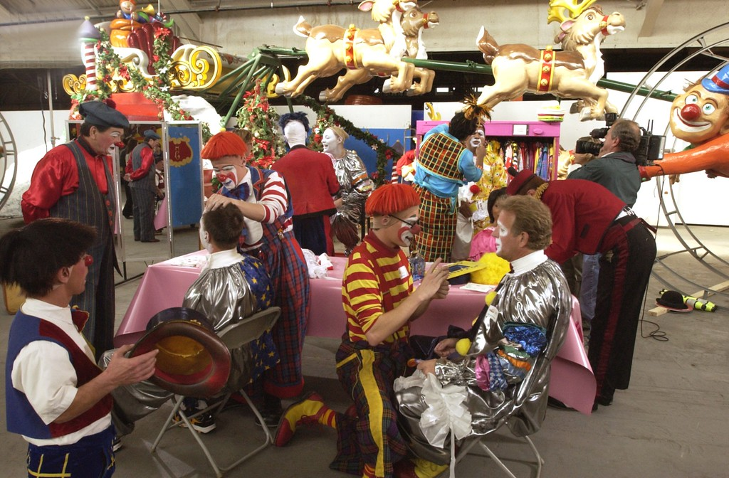 . Clown College at the Parade Company in Detroit. Clowns from Ringling Brothers held a clown college for some of this areas distinguished business people who will dress up and march in this years Thanksgiving Day Parade. Here the Ringling Brothers clowns help apply the make up to the business people.