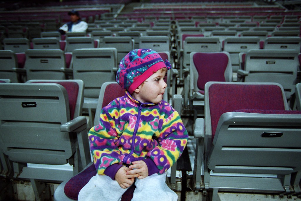 . Nicole Smirnova, 2 1/2, whose parents perform in the Royal Hanneford Circus watches rehearsal from a front row seat at the Palace.