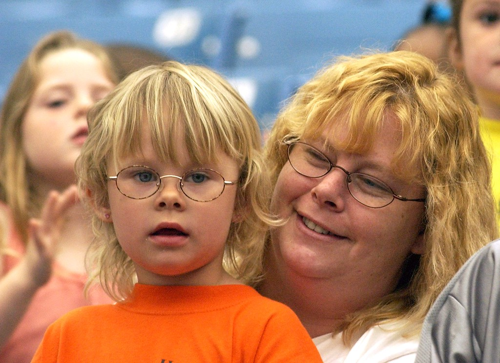 . Tracy Ollila and her 4 year old daughter Rachyl of Ferndale, watching the Schrine Circus Xtream at the Pontiac Silverdome.