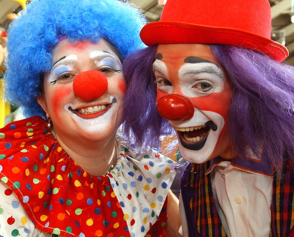 . Jena Passut, left, a Daily Oakland Press reporter and Ringling Bros. and Barnum & Bailey clown Kelly Ballagh share a laugh during Clown College held at the Parade Company in downtown Detroit.  Clowns from the Ringling Bros. and Barnum & Bailey worked with a group teaching make-up techniques, clowning skills and tricks and character development.