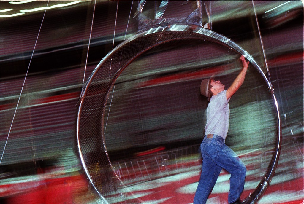 """. Aerialist Ivan Espana checks the rigging on the \""""SkyWheel\"""", a massive spinning metal device with hoops at each end during rehearsals of the Royal Hanneford Circus at the Palace of Auburn Hills. While standing in the hoop, Ivan and his brother Noe, do stunts as the hoops spins at increading speed until they reach zero gravity and can float in mid air inside the hoop."""
