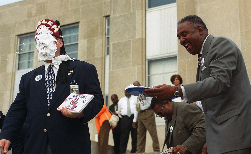 . Pontiac Mayor Walter Moore (right) laughs after dousing Shriner Thomas Taylor of the Moslem Shrine Temple with a pie Thursday in front of City Hall.The Shriners were gathered to celebrate the move of the circus to the Silverdome.