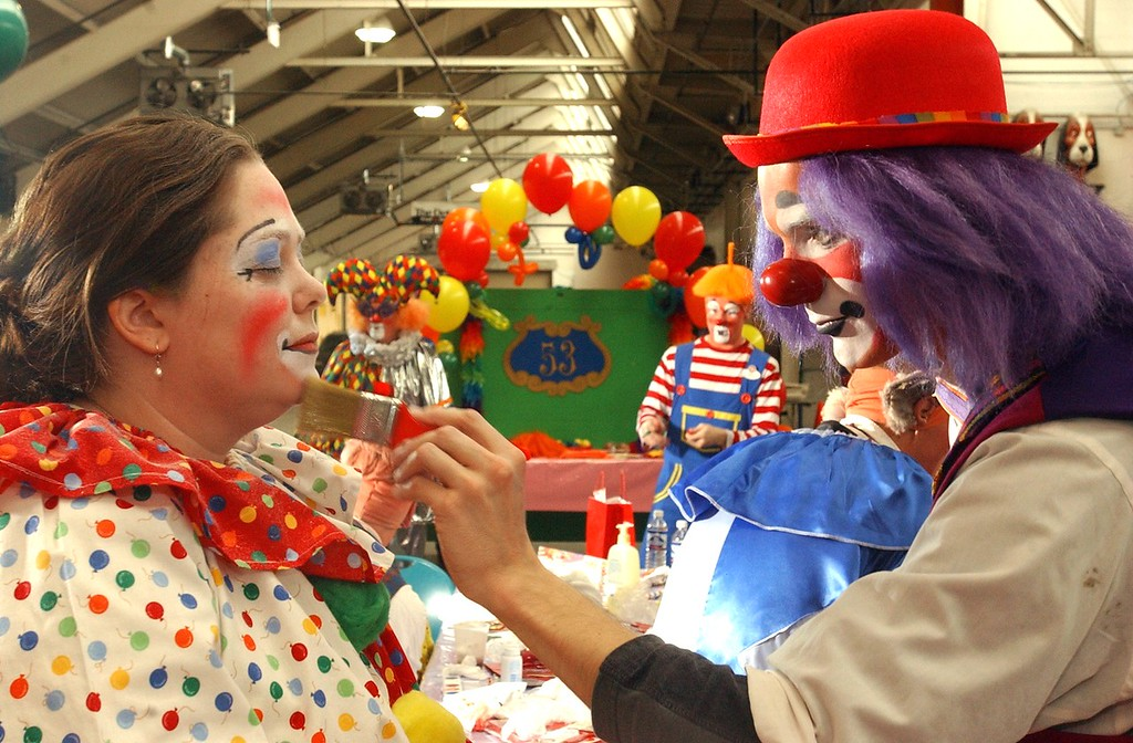 . Jena Passut, left, a Daily Oakland Press reporter has make-up applied by Ringling Bros. and Barnum & Bailey clown Kelly Ballagh during Clown College held at the Parade Company in downtown Detroit.  Clowns from the Ringling Bros. and Barnum & Bailey worked with a group teaching make-up techniques, clowning skills and tricks and character development.