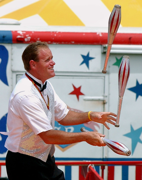 . One of the circus performers entertains the crowd with a juggling act.  Photo taken on Saturday, July 12, 2008, during the Oakland County Fair, held at the Springfield Oaks County Park in Davisburg, Mich.  (The Oakland Press/Jose Juarez)