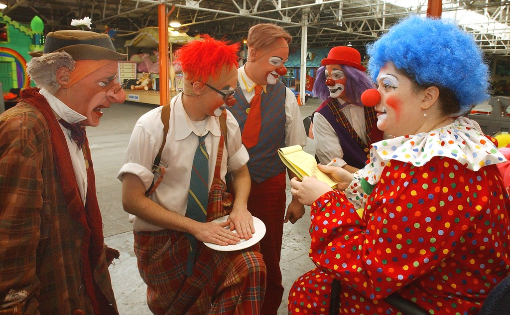 . Jena Passut, right, a Daily Oakland Press reporter takes notes as she chats with a group of Ringling Bros. and Barnum & Bailey clowns during Clown College held at the Parade Company in downtown Detroit.  Clowns from the Ringling Bros. and Barnum & Bailey worked with a group teaching make-up techniques, clowning skills and tricks and character development.
