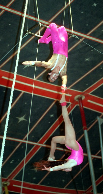 . Marcos and Gabriela Cavallini perform during an aerial act at the circus in downtown Pontiac Friday.