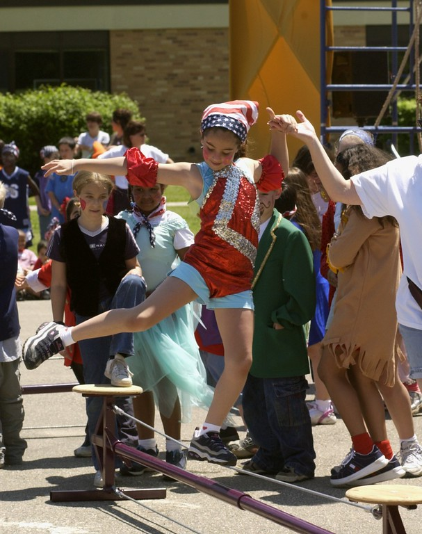 . Green Elememtary performed a three ring circus in front of the entire student body today. One of the tightrope walkers performing is Natalie Choulagh, a 2nd grader, 8 years old.