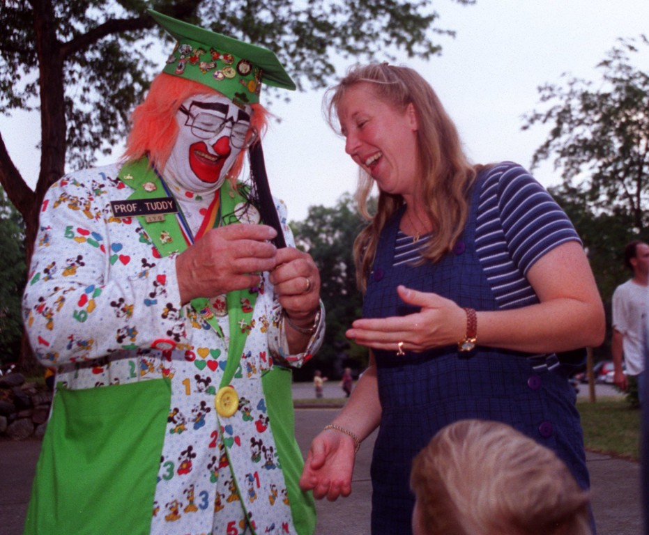 . Detroit Shrine Circus Clown Prof. Tuddy (Lyle Blevins) jokes around with Michele Connelly, showing her a trick with a tiny wood toy, at the Family concert sponsored by the Oxford Masonic Lodge at Stoney Lake Park last week.