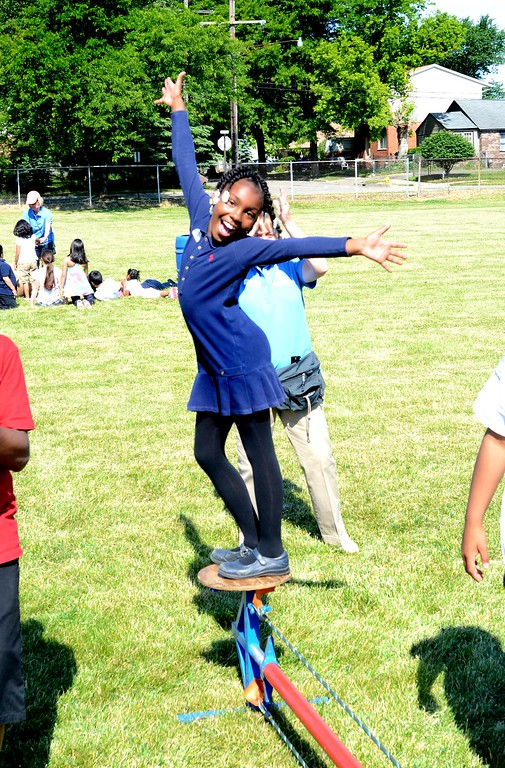 . ***WITH VIDEO***   A\'miyah Gordon, 8, celebrates walking the tight rope at Jefferson Whittier School in Pontiac.  Kirk in the Hills of Bloomfield sponsored the unique learning experience for the students call Circus Amongus.  The second graders trained on 10 different circus acts and put on a big top show for the entire school in the afternoon.   Friday, June 8, 2012.  The Oakland Press/TIM THOMPSON