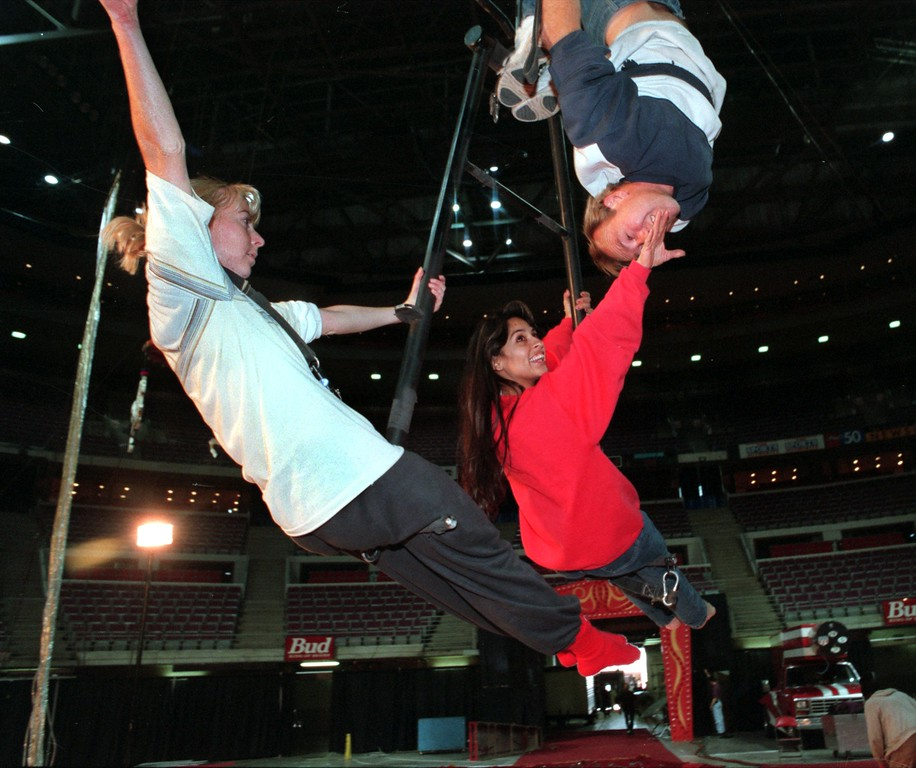 . Royal Hanneford Circus acrobats Rachel Cretney (left), Alexandra Castor and Trevor Boswell rehearse their performance for Friday night\'s show at the Palace of Auburn Hills.