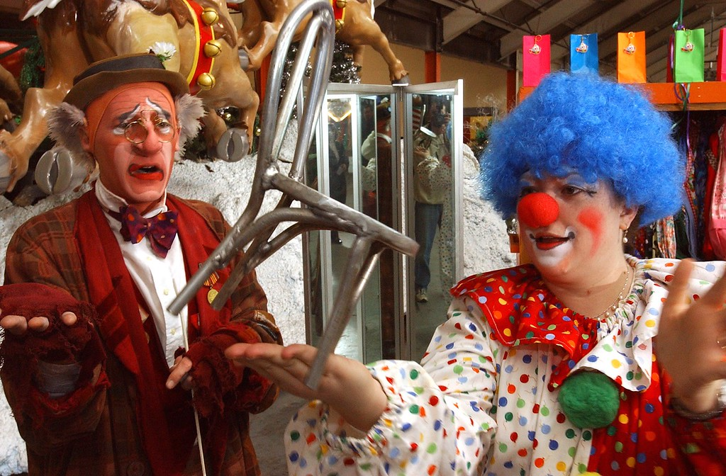 . Jena Passut, right, a Daily Oakland Press reporter learns how to balance a minuture chair from Ringling Bros. and Barnum & Bailey Grampa clown during Clown College held at the Parade Company in downtown Detroit.  Clowns from the Ringling Bros. and Barnum & Bailey worked with a group teaching make-up techniques, clowning skills and tricks and character development.
