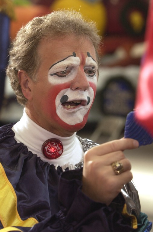 . Clown College at the Parade Company in Detroit. Clowns from Ringling Brothers held a clown college for some of this areas distinguished business people who will dress up and march in this years Thanksgiving Day Parade. This is Jeff Sadowski of Birmingham as he gets a look at his face makeup.