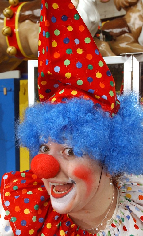 . Jena Passut, left, a Daily Oakland Press reporter poses for the camera after make-up during Clown College held at the Parade Company in downtown Detroit.  Clowns from the Ringling Bros. and Barnum & Bailey worked with a group teaching make-up techniques, clowning skills and tricks and character development.