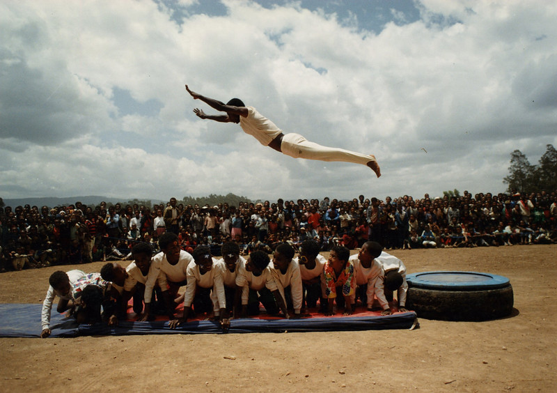 Yared Esheu, the second Circus Ethiopia Coach, flying over 13 mebers of Circus Ethiopia in an early public show in Addis Ababa