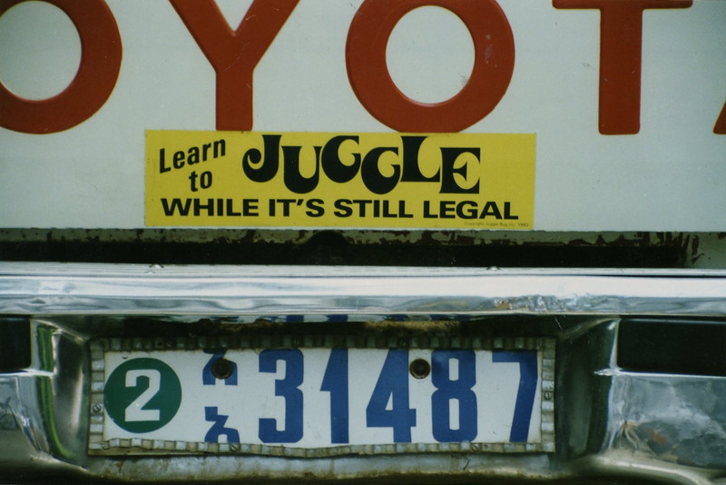 """""""Learn to Juggle while it is still legal"""" bumper sticker on Andrew Goldman's truck (bottom) 1990"""