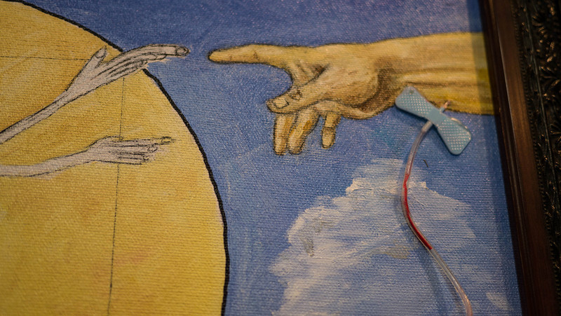 FutureMed Detail 2 ...Close up of DaVinci's hand reaching for Michaelangelo's hand of God.  Not real blood in IV tubing.