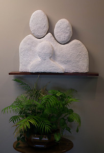 "Sculpture of Horizon's Logo in my office ...approximately 36 x30"" Probably the last sculpture I will do. Well received and has the look of solid stone. Almost made the heads bobble. (should have)"
