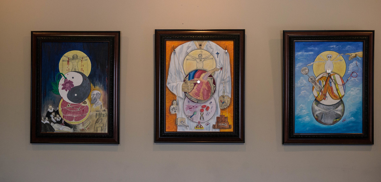 Medicine Triptych. Inspired by Diego Rivera's work and originally intended to be a mural.  A triptych was much more practical.  DaVinci's man is transformed over time. Lower spheres showcase advances in medicine.  Each painting has many symbols and tells a story. (described in captions below each photo). The second and third paintings are mixed media  that includes oil paint.
