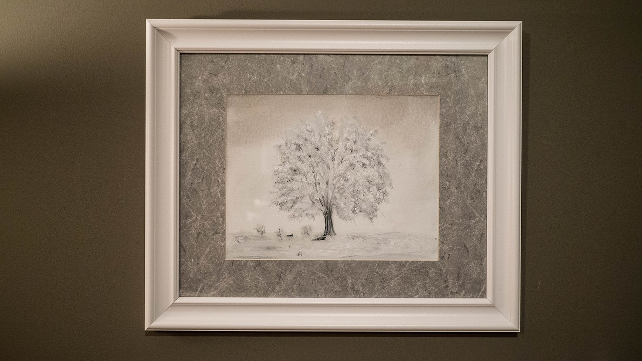 """Sister Tree ...Black and White Oil on Canvas board 12 x 16 """" On this piece the canvas was primed with white gesso. I moved to the darker tones and added the snow. I did the exact opposite with the brother tree."""